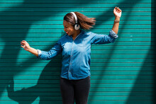Happy Afro Woman Listening Mus...