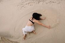Unrecognizable Dancer Splashin...