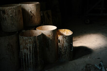 Metal Rusty Barrels In A Foundry