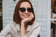 Portrait Of A Attractive Woman Wearing Trendy Sunglasses