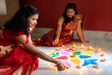 Indian Women Lighting Oil Lamp...