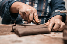 Mexican Artisan Sculpting With...