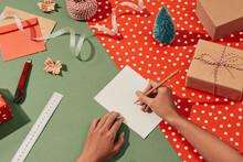 Female Hand Writes In A Notebook Among New Year's Gifts