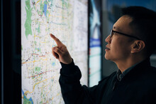 Businessman Looking At The Map...