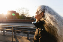 Senior Woman Walking On The St...