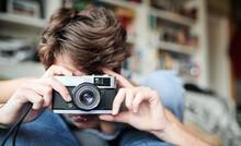 Focused Photographer Lying On ...