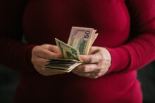 Female Hands Holding Money