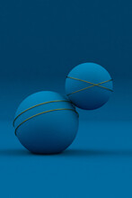 Abstract Blue Ball With Golden Rings