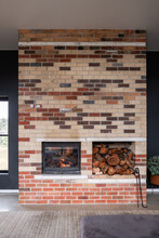 Contemporary Home With Brick Thermal Mass Designed Fireplace