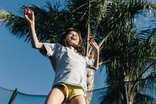 Girl Jumping In Trampoline