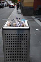 Overflowing Trash Bin In City Filled With Recyclable Products