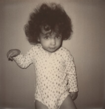 Polaroid Black And White Photo Of Kid Looking At Camera