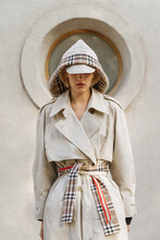 Fashion Photo Of A Girl Dressed In The Style Of Sherlock Holmes