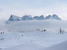 Les Dents Du Midi, With In Front Some Tiny Skiers And Ski Lifts, The Alps