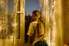 Girl Looks Out Of Window