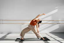 Young Active Woman Doing Yoga ...