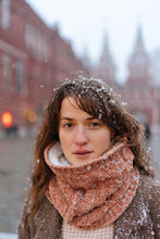Portrait Of A Beautiful Brown-haired Woman On A Snowy Red Square In Moscow