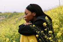 Pensive Black Woman In Flowery...