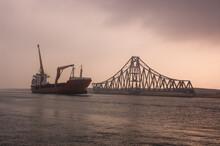 Cargo Ship Passing Alongside E...