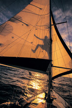 The Shadow Of A Sailor Is Checking His Sails At Sea