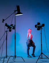 The Girl With Pink Hair In A Color Light At The Studio With Light Equipments