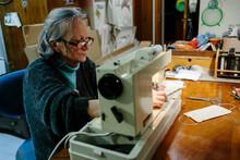 Elderly Woman Sewing Homemade ...