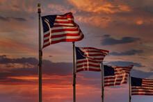 American Flag Backlit By Wavin...