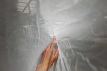 Female Hand Under A White Fabric, Isolation