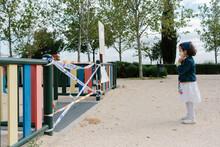 Kid Looking At Sealed Playground