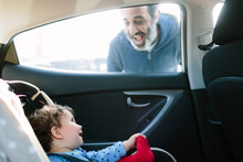 Baby Inside A Car Smiling At Dad