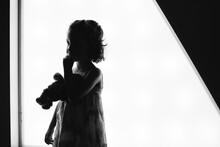 Kid In Backlight Over White Tr...