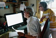 Elderly Couple On Computer
