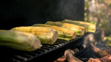 Chef Cooking BBQ With A Corn O...