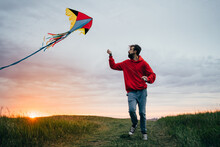 Young Man With Flying Kite