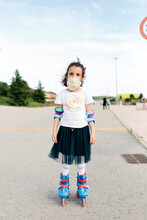 Kid On Inline Skates With Protective Mask