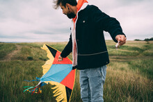 Man With Colorful Flying Kite ...