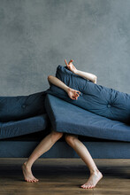 Girl On The Sofa Stuck In Pillows