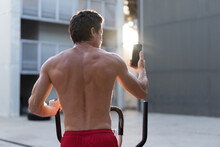Back View Of Athletic Male Wit...