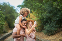 Cheerful Multiethnic Parents W...