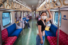 Side View Of Ethnic Female Wearing Protective Mask Traveling By Train During Coronavirus Outbreak