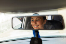 Young Cheerful Female Driver S...