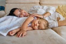A Little Girl Sleeping With He...