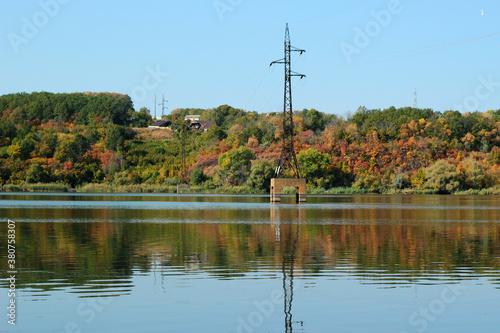 Fototapeta Electricity pylon stands in a lake