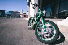 Green Motorbike In A City Parking Lot