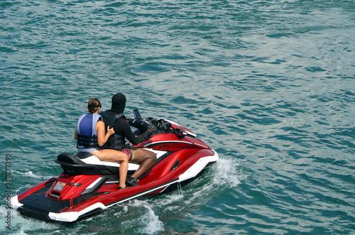 Obrazy Sporty Wodne   man-and-a-woman-riding-tandem-on-a-jetski