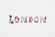 London Written With Old Grungy Union Jack Letters On White Background