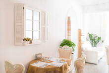 Elegant Dinning Table And Chair Beside Woll With White Shutter