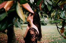 Young Woman Among Magnolia Leaves