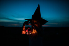 Child With Hat Of Halloween And Light In The Hands