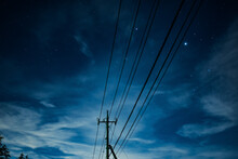 Night Sky With Stars And Utility Poles